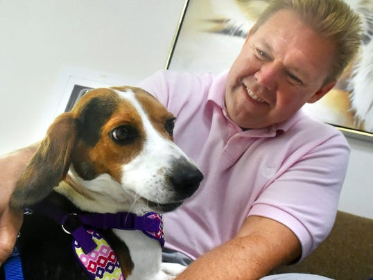 Trooper is a beagle who was brought into the Cumberland Valley Animal Shelter Aug. 1 with severe rope burns. Sen. Rich Alloway, shown Monday with the rescued dog, has introduced legislation to prevent dogs from being tied up without care.