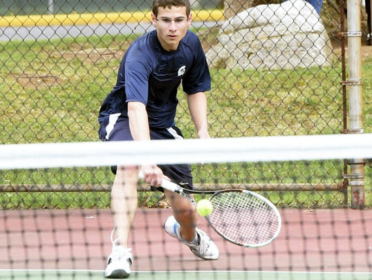 Chambersburg's Aaron Palm returns a ball against Central Dauphin on Monday at Memorial Park. The Rams won a rain-shortened match, 3-0.