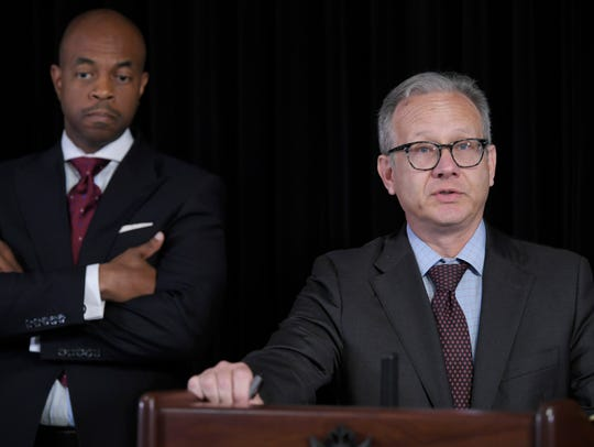 Mayor David Briley speaks at a press conference on the officer-involved shooting of Daniel Hambrick Wednesday, Aug. 8, 2018 at the Mayor's Media Room in the Metropolitan Courthouse in Nashville, Tenn. State Rep. Harold Love is in the background.