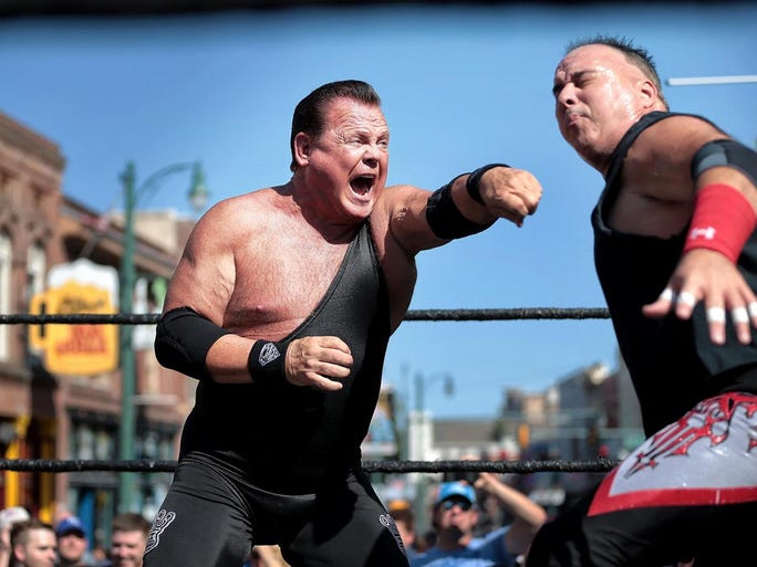 September 3, 2015 - In a classic Memphis move, Jerry 'The King' Lawler wrestles Doug Gilbert (right) on Beale Street during the grand opening of Lawler's new restaurant. At 3pm -- the equivalent of a Memphis high noon -- wrestling fans gathered around a makeshift ring in the middle of Beale to watch some wrestling greats like Lawler, Bill 'Superstar' Dundee, and Koko 'Birdman' B. Ware.