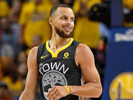 Golden State Warriors guard Stephen Curry (30) reacts