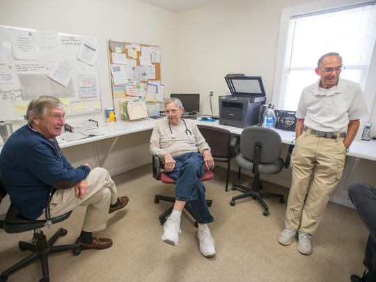 Retired and now clinic volunteer doctors David Conkle,