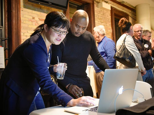 Former St. Cloud school board member Debra Erickson and Superintendent Willie Jett watch the early returns on the district referendum with supporters in November 2016 at D.B. Searle's.