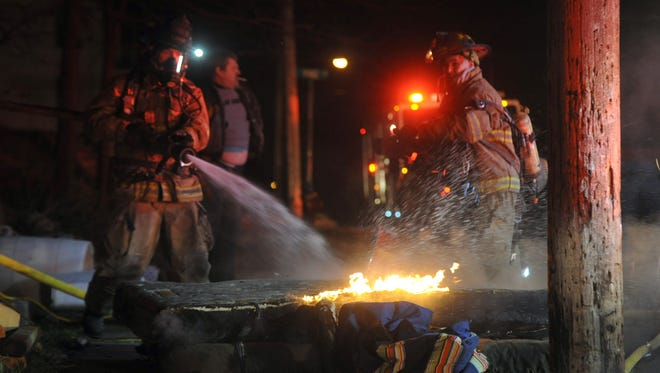 Zanesville Fire Department firefighters put out a small fire on a mattress that was pulled from a Luck Avenue home Wednesday night in Zanesville after a fire caused significant damage to the home's interior. No injuries were reported in the incident.