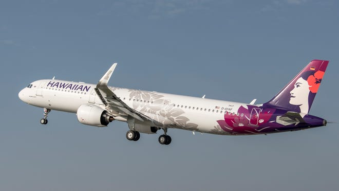 One of Hawaiian Airlines' first Airbus A321neo jets is seen flying in an undated photo.