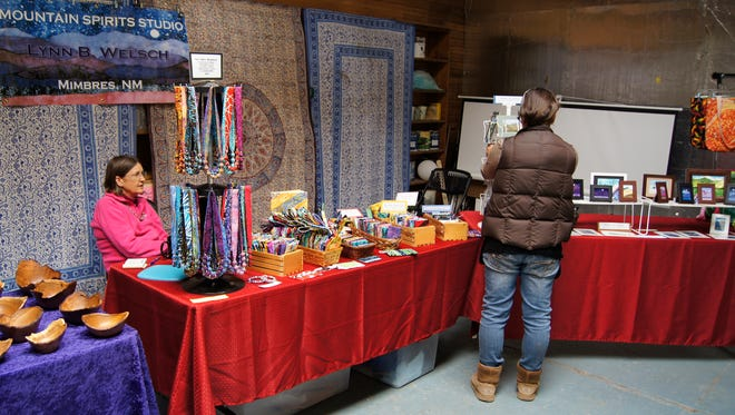 Mountain Spirits Studio, owned by Lynn Welsch of Mimbres, displayed jewelry at Saturday's Artisan Market in Silver City.
