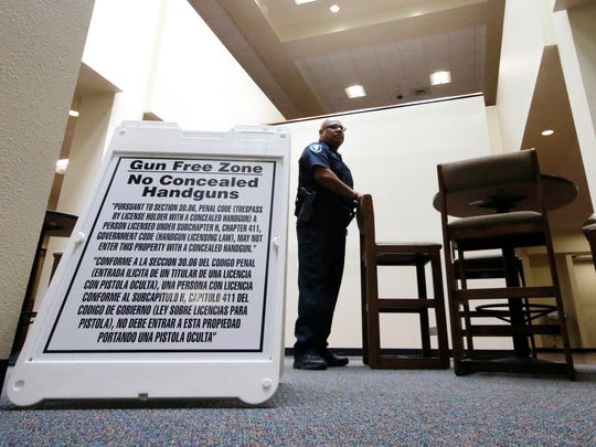 "Tuesday will be the first day that concealed carry will be allowed at community colleges across the state of Texas. Here, a sign is posted in the lobby of the Student Services Building. It will be posted any time there is a meeting of the El Paso Community College board, identifying it as a ""Gun Free Zone."""
