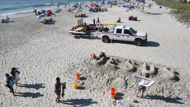 People at Wrightstville Beach on Saturday enjoying Labor Day weekend.