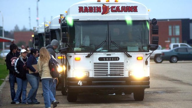 UL students climb aboard a bus bound for campus Tuesday morning at Cajunfield.By Leslie WestbrookJanuary 16, 2007