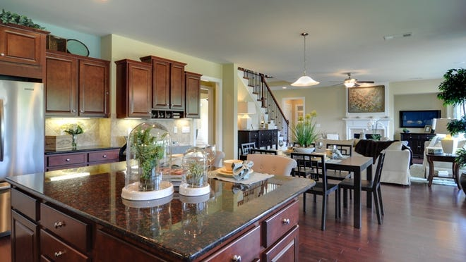 Kitchens have General Electric Profile appliances and granite countertops.