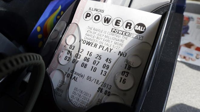 FILE - A Powerball lottery ticket is printed out of a lottery machine at a convenience store in Chicago on in this May 18, 2013 file photo. According to lottery officials there were no jackpot winner for Saturday Feb. 15, 2014 drawing. The current estimated jackpot for Wednesday's drawing's jackpot is estimated at $400 million or $227.8 million in cash value. (AP Photo/Nam Y. Huh, FILE)