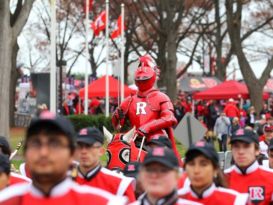 The Rutgers Scarlet Knights marching band heads to