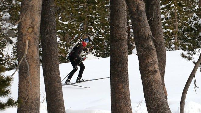 Nikolas Burkhart skis his way up a short hill while training for the Biathlon at the ASC Training Center at the Auburn Ski Club near Truckee, Calif., on Jan. 24, 2018.