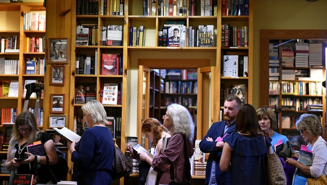 At Jackson's Lemuria Books, author events -- such as this 2017 John Grisham signing -- helped create excitement and drive sales, especially around the holidays. They aren't possible this year due to the pandemic.