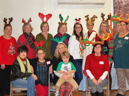 Reindeer Party – Vanderburgh County CASA hosted their annual Holiday Open House with the theme of Santa's Reindeer.  The staff spent the afternoon spreading Christmas Cheer to their guests! Front row from left are Rebecca Brown, Yvonne Mans, Casey Blake and special guest, Tommy Blake and Shannon Schultz. Back row includes Karen Hysell, Suzanne Draper, Trish Brown, Sally Carr, Renee Minnette, Dana Lewis, Christine Lutz and Debby Gamache.