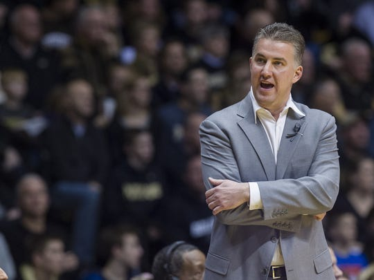 Purdue head coach Matt Painter reacts toward an official after a foul call early in the first half of an NCAA college basketball game, Saturday, Jan. 25, 2014, in West Lafayette, Ind.