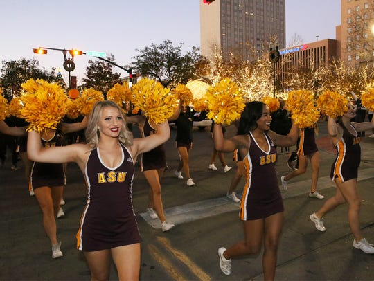 Carson Edwards, left, and the Arizona State cheerleaders