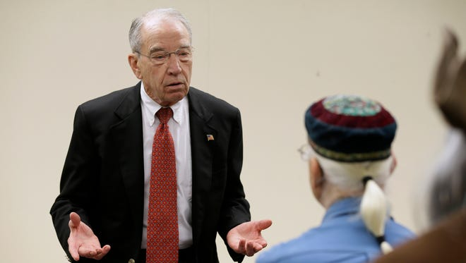 Senate Judiciary Committee Chairman Chuck Grassley, R-Iowa, speaks to Dave Damstrom of Spencer, right, during a town hall meeting at the Ocheyedan Senior Center, Monday, March 28, 2016, in Ocheyedan. (AP Photo/Charlie Neibergall)
