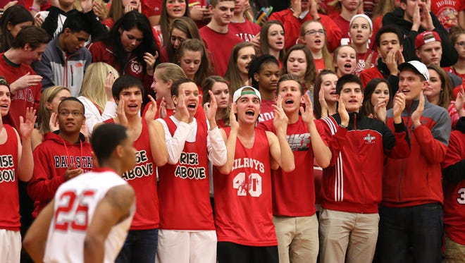 Lawrence North fans cheer on their team against Carmel at Lawrence North Friday February 6, 2015. Carmel won 52-49.