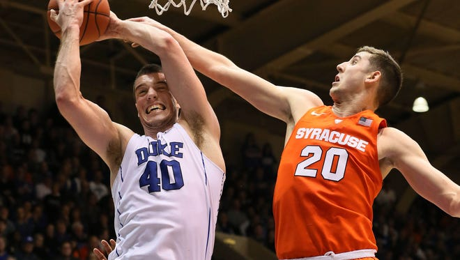 Syracuse freshman forward Tyler Lydon tries to block a shot in the Orange's 64-62 win at Duke on Monday.