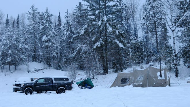 Heavy snow turned Minnesota's Boundary Waters region into a giant black-and-white picture during the first week of the state's firearms deer season.