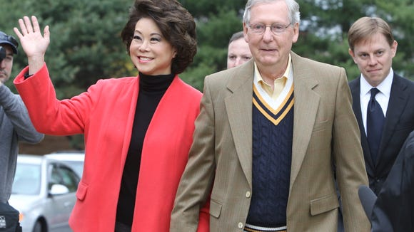 Senator Mitch McConnell arrives with wife Elaine Chao