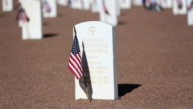 Each grave marker at Fort Bliss National Cemetery was decorated with a U.S. flag.