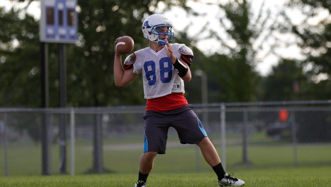 An Auburndale player throws a pass during practice August 5, 2016.