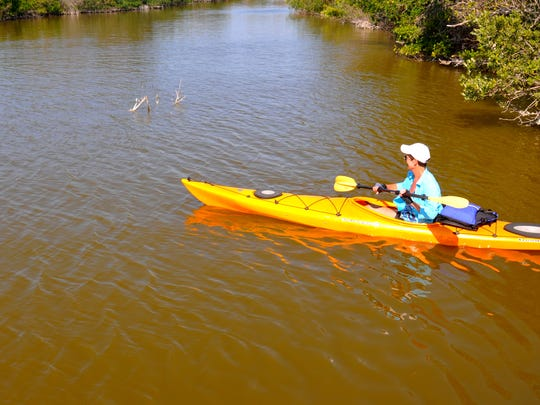 Wendy McKee paddles out into the Banana River from