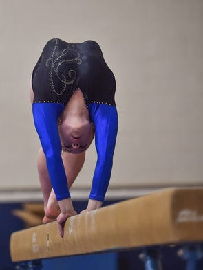 Waynesboro's Alex Stoops on the balance beams during