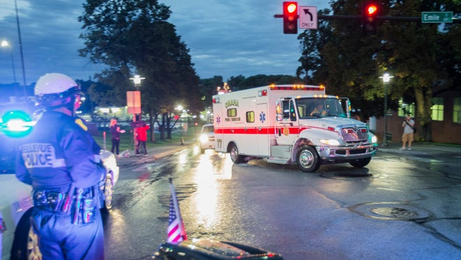 The ambulance transporting Dr. Rick Sacra, 51, who was infected with Ebola while serving as a family medicine doctor in Liberia, arrives to the Nebraska Medical Center in Omaha, Neb., Friday, Sept. 5, 2014. Sacra, who served with North Carolina-based charity SIM, is the third American aid worker infected by the Ebola virus.