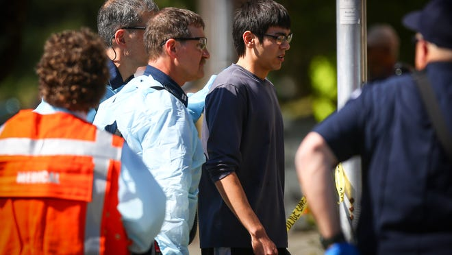 Jon Meis is taken from the scene by medics June 5 after he pepper sprayed and tackled a shooting suspect at Seattle Pacific University, in Seattle.