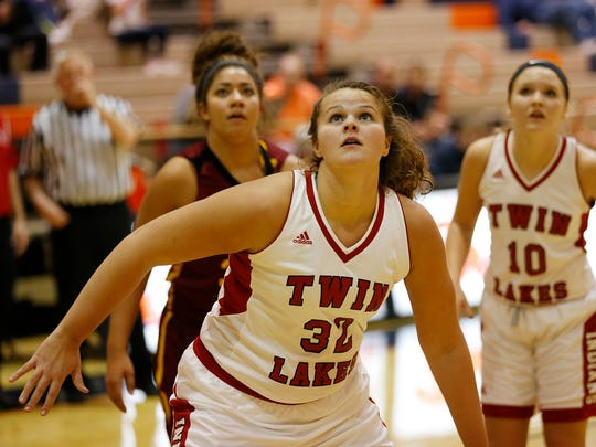 Taylor Burns to Twin Lakes positions herself for a rebound as the Indians face McCutcheon in the Franciscan Health Hoops Classic Monday, November 13, at Harrison High School. McCutcheon defeated Twin Lakes 67-52.