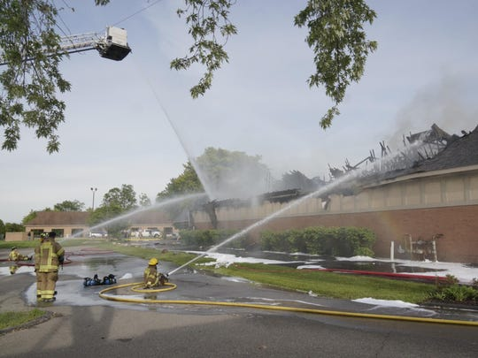 Canton Center Road was blocked to allow firefighters to fight the blaze at the Canton City Car Wash, just north of Ford Road.