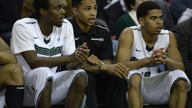 UW-Green Bay lost its first-round game of the 2014 National Invitation Tournament, 80-65 to Belmont at the Resch Center. Star player Keifer Sykes, center, missed that game because of an ankle injury.