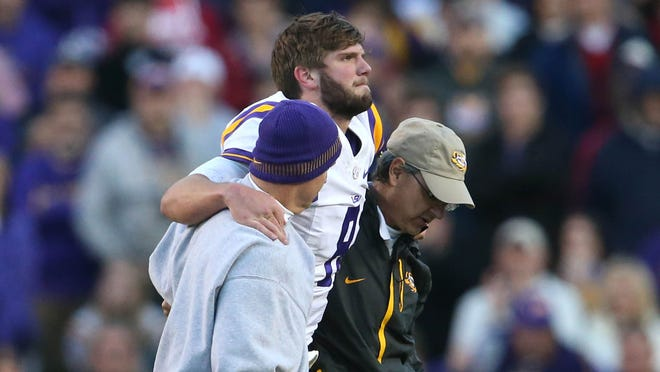 LSU quarterback Zach Mettenberger is helped off the field after being injured in the fourth quarter against Arkansas on Nov. 29.