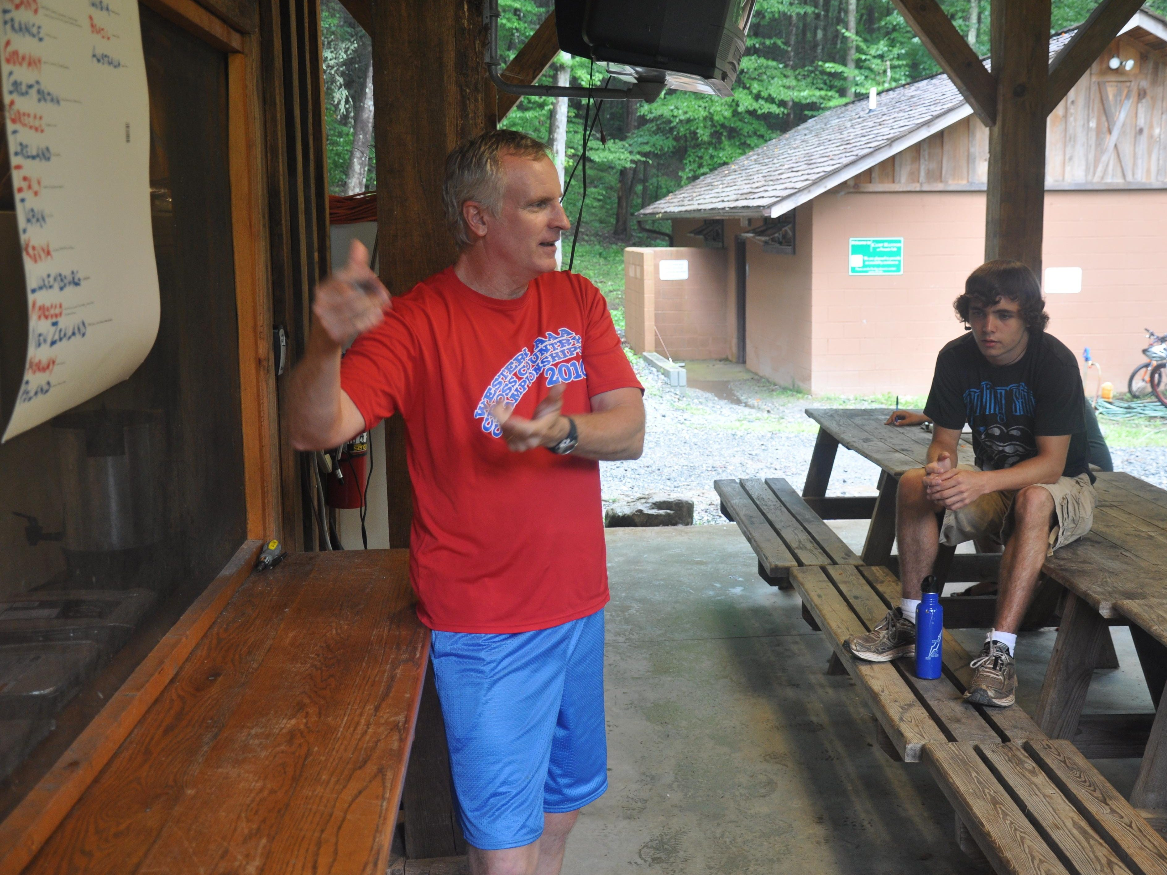 Dan Shonka talks with his captains at Camp Hannon in Sunset during one of his final seasons as Daniel's coach. Shonka will be inducted into the South Carolina Track and Cross Country Coaches Association Hall of Fame Saturday in Columbia.