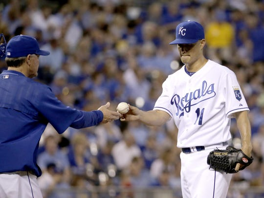 Royals starting pitcher Jeremy Guthrie, right, hands