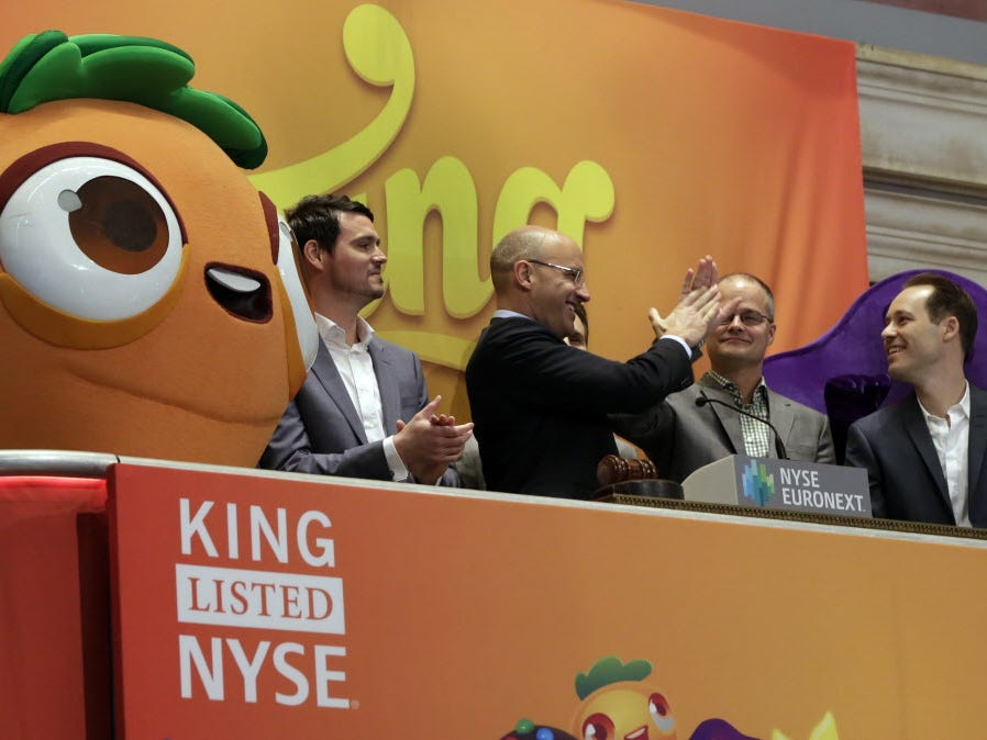 King Digital Entertainment CEO and founder Riccardo Zacconio second left, high-fives with company co-founder Lars markgren, the maker of Candy Crush Saga and Farm Heroes Saga, during  opening bell ceremonies at the New York Stock Exchange, before Kin