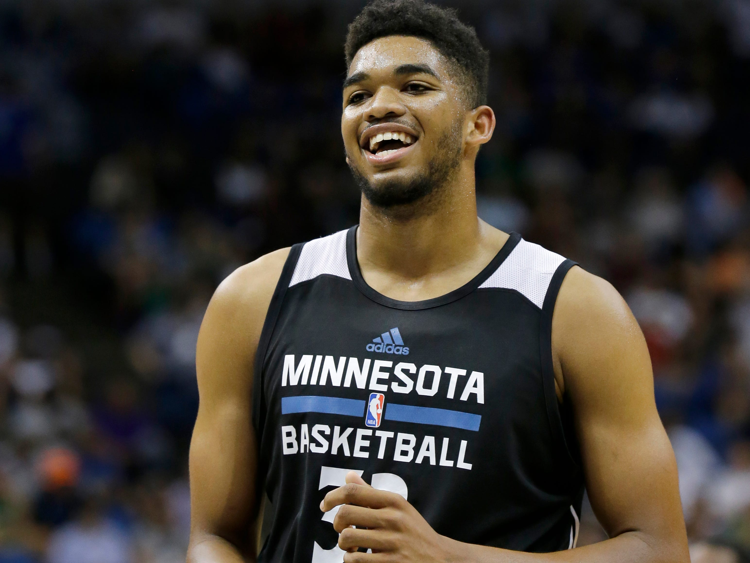 Minnesota Timberwolves center Karl-Anthony Towns laughs at a teammate during an NBA basketball scrimmage in Minneapolis, Wednesday, July 8, 2015. (AP Photo/Ann Heisenfelt)