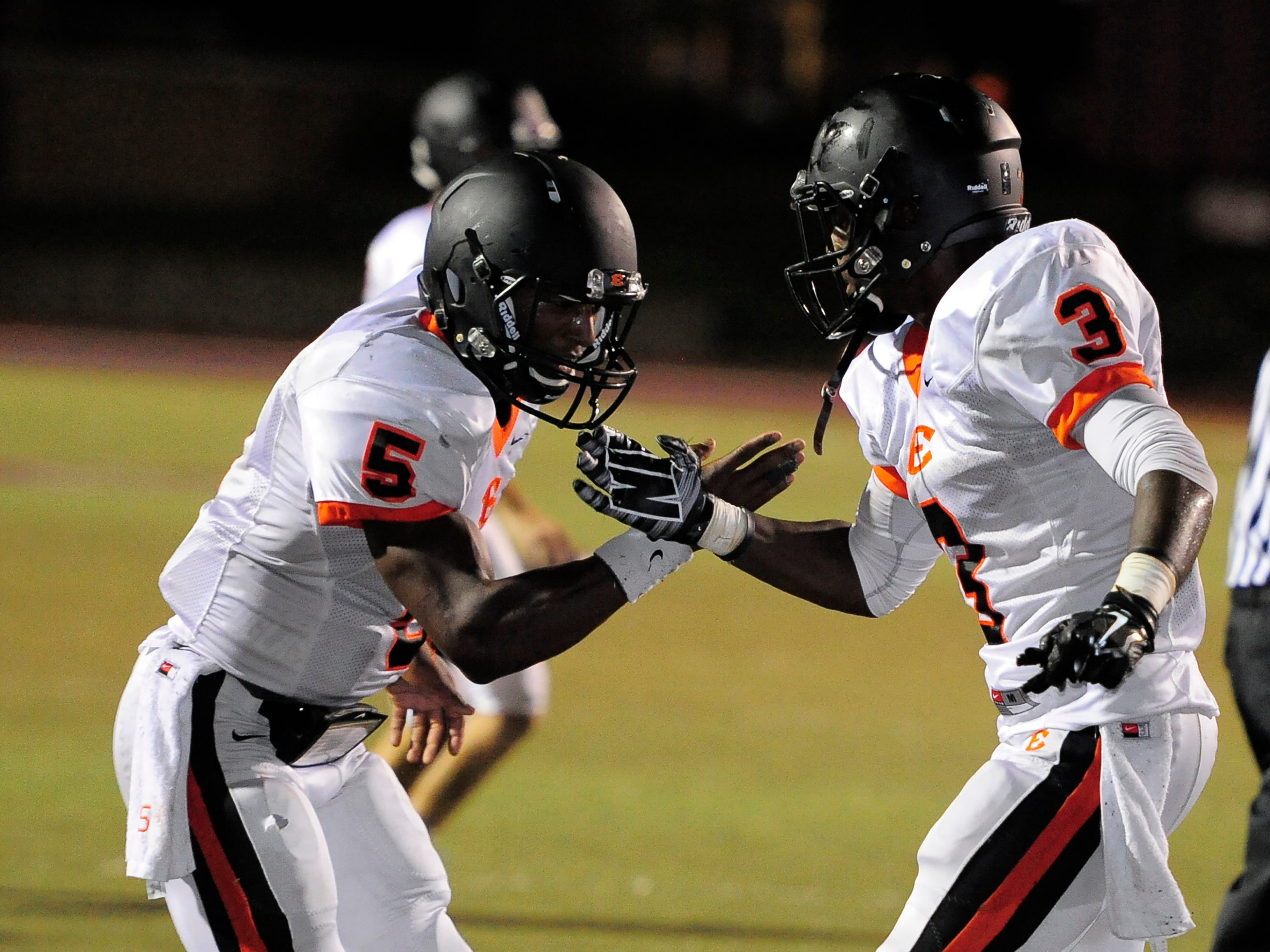 Quarterback P.J. Settles (5) and running back Darius Morehead (3) have helped Ensworth to a 6-1 start to the season.