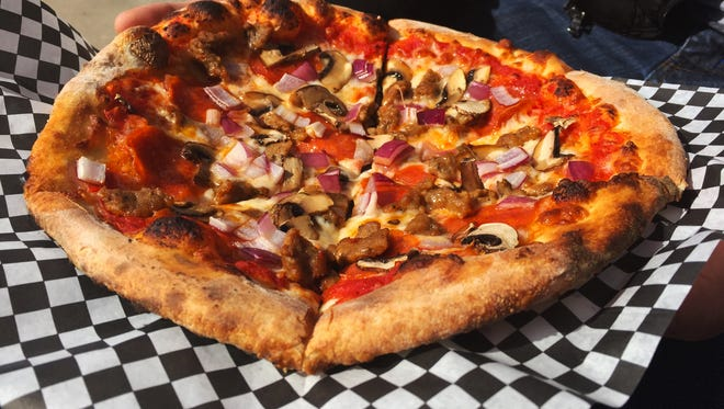 The Brooklyn Pizza from Joshua's Pie is topped with Italian sausage and pepperoni, red sauce, mozzarella, provolone, red onion and mushrooms on sourdough crust with garlic-infused olive oil and sea salt ($8.50).