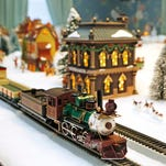 Two 0n30 scale trains runs through an upstairs bedroom Tuesday, November 24, 2015, inside the Haan Mansion Museum in Lafayette. Christmas tours of the Haan Mansion Museum will take place November 28 and 29 and also on December 5 and 6.