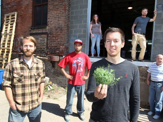 The staff of Waterfields, a hydroponic microgreens business, from left, Dan Divelbiss, chief growing officer; Michael Whitt, production assistant; Julz Bressler, assistant grower; Daniel Klemens, marketing manager, with Wacky Peas, one of the company's most popular products; Sam Dunlap, director of operations; and Paul Leffler, chief financial officer.