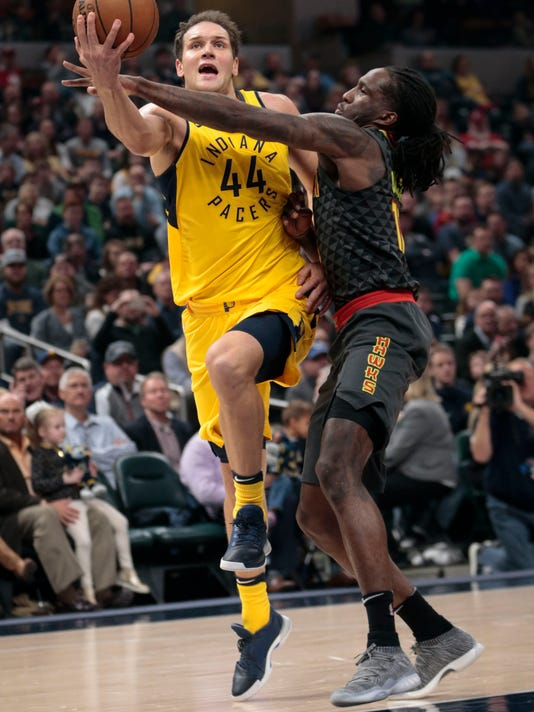 Indiana Pacers forward Bojan Bogdanovic (44) is fouled by Atlanta Hawks forward Taurean Prince during the first half of an NBA basketball game in Indianapolis, Friday, March 9, 2018. (AP Photo/AJ Mast)