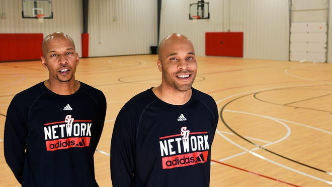 Kasib Powell (right) and Sean Ladd (left), co-founders of South Dakota Network Basketball, pose for a portrait in their new training facility located in Sioux Falls on Friday, Oct. 20, 2017.