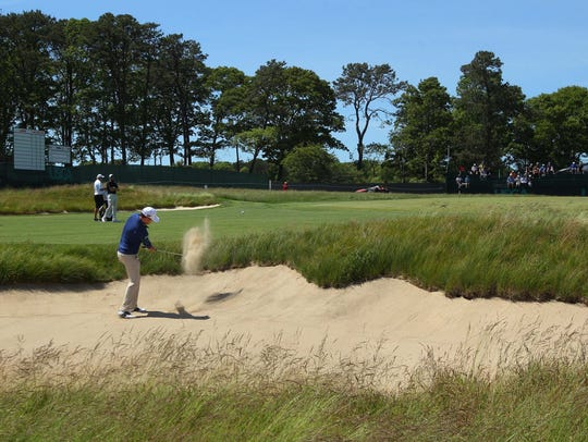 Zach Johnson hits onto the No. 3 green from a bunker