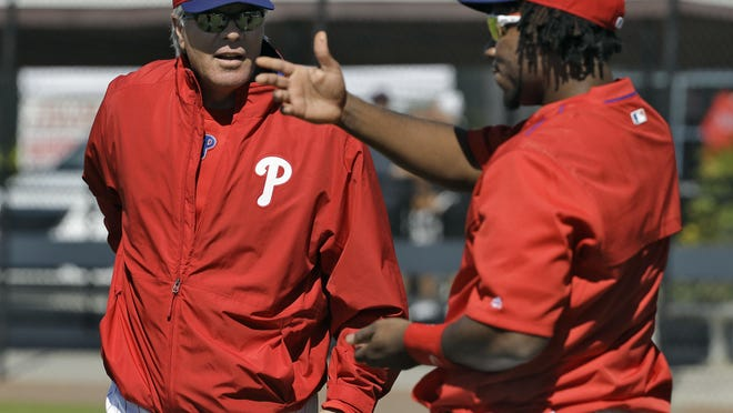 Philadelphia Phillies manager Pete Mackanin, (left) talks to third baseman Maikel Franco during a spring training baseball workout last month. Franco has a big game Friday against the Atlanta Braves.