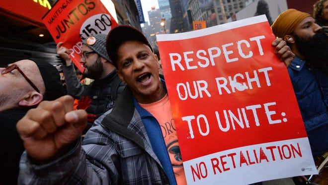 Demonstrators protest outside a McDonald's restaurant near New York Times Square as part of a nationwide protest of fast-food workers Dec 5.