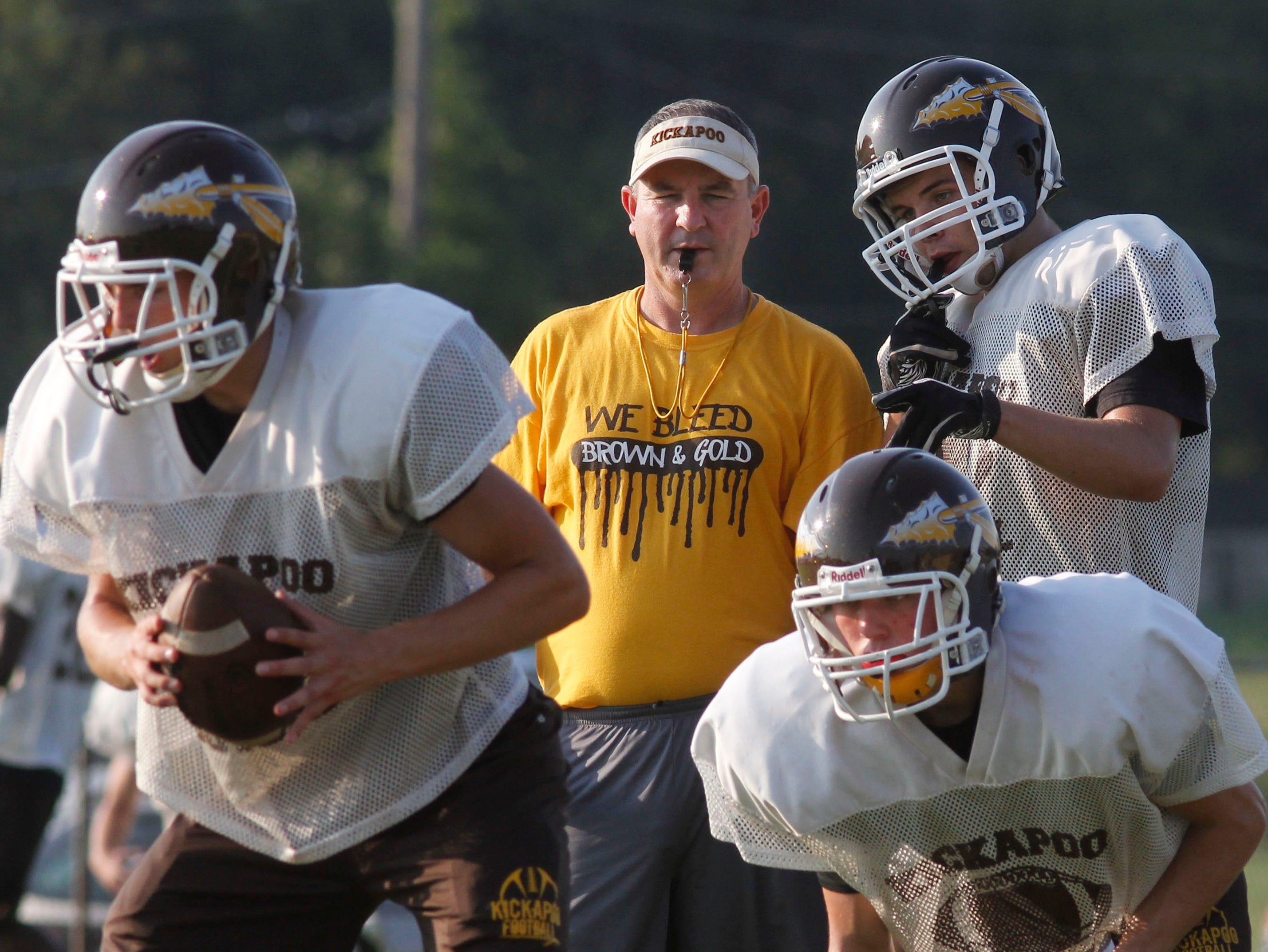 Kickapoo's Joel Wells takes a business-like approach into the pre-game speeches to his team.